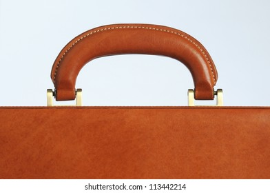 close up of the handle on a leather business briefcase