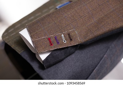 close up handmade buttonholes male jacket