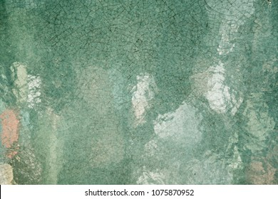 Close up handmade glazed pottery ceramic art texture surface, dark green. Reflection from smooth surface.  Abstract vintage, contemporary, antique style wallpaper background.