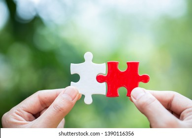Close up of hands business women connecting jigsaw puzzle, Business Success,  Teamwork workplace success and strategy concept.