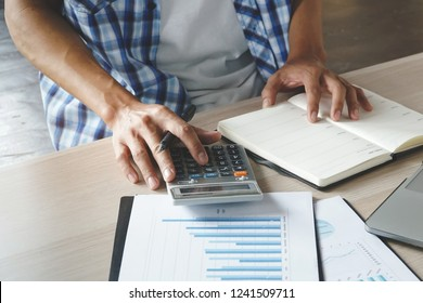 Close up hands of businessman using calculator and preparing tax payment