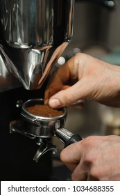 Close up of hands checking grinded coffee