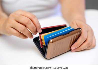 Close up of hands choosing and picking a credit card.
