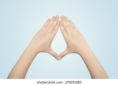 Close up of hands creating a form