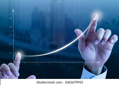 Close up of a businessmanâ??s hands drawing an exponential line curve showing of business growth and success rapidly.