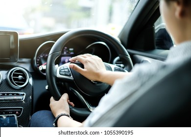 Close up Hands driving and Honking on Luxury Car with Blur Man as Foreground
