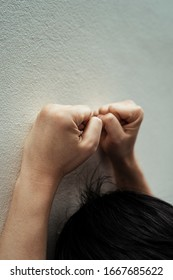 Close up hands of furious businessman attacking the wall. Headbutt the wall. Sad and depressed.
