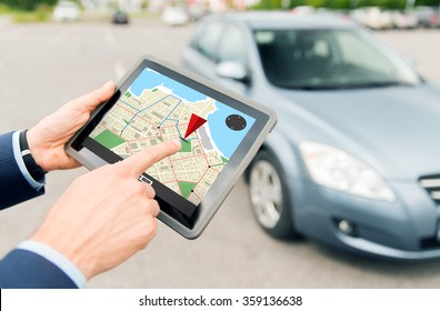 close up of hands with gps on tablet pc and car