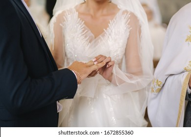 Close up hands of groom and bride in the church. wedding