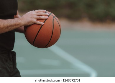 Close up of hands holding basket ball