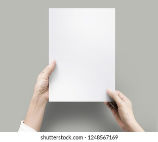 Close up hands holding blank paper for work at desk office top view. clipping path, Isolated.