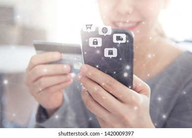 Close up hands holding credit card and using mobile smart phone with icon Online shopping, E-Commerce.