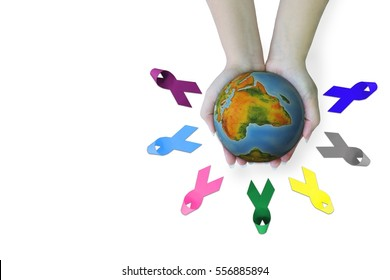 Close up hands holding the orb and Awareness ribbons of common cancer .Threat from cancer Social campaign against cancer concept.Elements of this image furnished by NASA.
