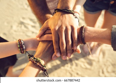 Close up of hands holding together at the beach