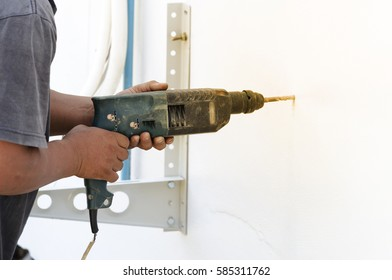 Close up hands of man use electric drill,Hands working concept