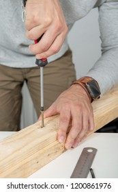 a close up of hands of  man using screwdriver