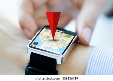 close up of hands with map on smartwatch screen