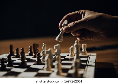 Close up of hands of men playing chess.