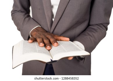 close up of hands of person flipping through a bible