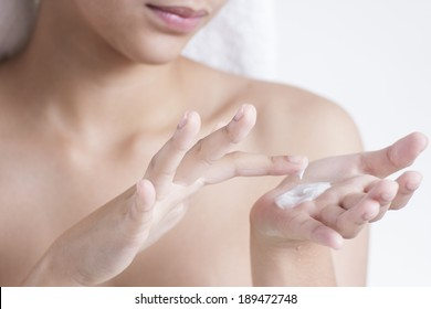 Close up of hands with skin lotion.