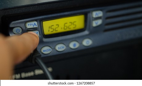 Close up of Hands are turning the ham radio transceiver.