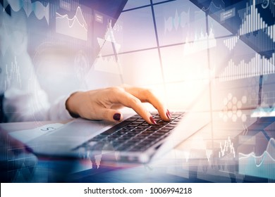 Close up of hands using laptop with abstract digital business interface. Future, innovation and future concept. Double exposure