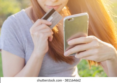 Close up hands using mobile smart phone and holding credit card outdoor, Online shopping,