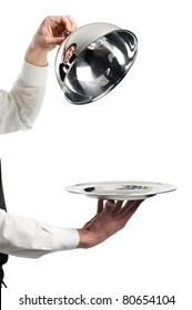 Close up hands of waiter with restaurant metal cloche lid cover