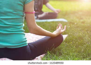 Close up hands. Woman do yoga outdoor. Healthy and Yoga Concept