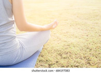 Close up hands woman do yoga,Asian girl doing yoga in garden with morning light