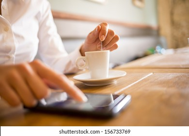 Close up of hands woman using her cell phone in restaurant,cafe