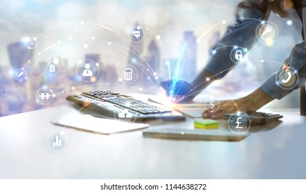 Close up hands of woman, who working in office against of City view. Holding pen, working on calculator and keyboard, calculate business data. Charts and graphs at the background