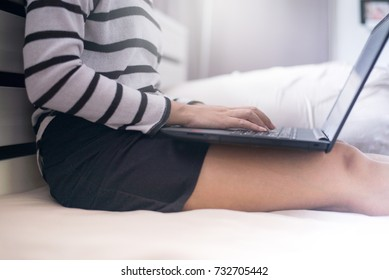 Close up hands woman working using laptop and connecting wifi on bed