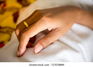 Close up of hands of women showing the ring with Gold
