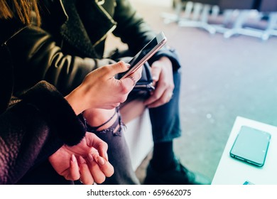 Close up hands of young couple using smart phone - technology, social network, communication concept - colorful filtered