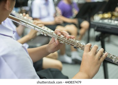 Close up hands of young flute player,musician