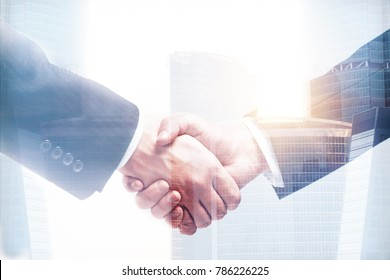 Close up of handshake on abstract bright city background. Teamwork and partnership concept. Double exposure