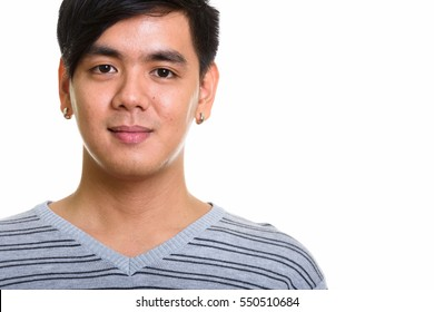 Close up of handsome Asian man isolated against white background
