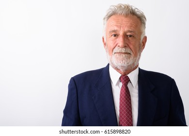 Close up of handsome senior bearded businessman against white background