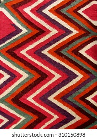 Close up of a hanged colourful handmade traditional wool rug - abstract background 8