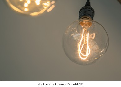 Close up to the hanging light bulb from the ceiling decorated in the room
