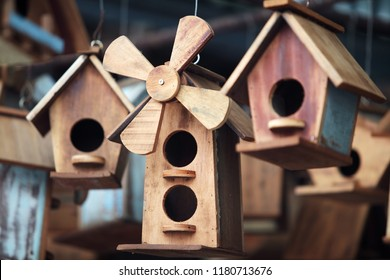 close up of hanging small wooden bird house