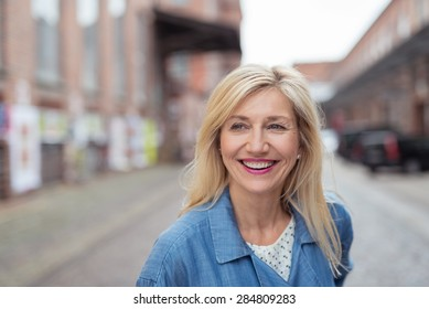 Close up Happy Adult Woman with Long Blond Hair, Laughing While Walking at the City Street