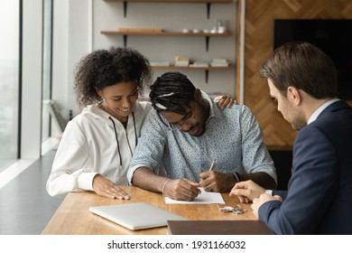 Close up happy African American family signing contract with manager realtor financial advisor, making investment or insurance deal, purchasing real estate, new house, taking loan or mortgage