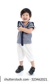 Close up of Happy asian boy in sailor uniform on white background isolated