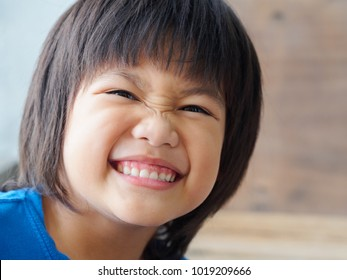 Close up Happy boy child is smiling enjoying life. happy family concept.