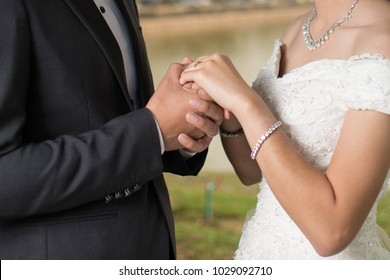 Close up of a happy couple holding hands. Engagement. Wedding Love.
