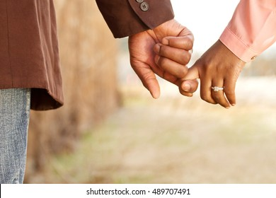 Close up of a happy couple holding hands.  Engagement. Love.