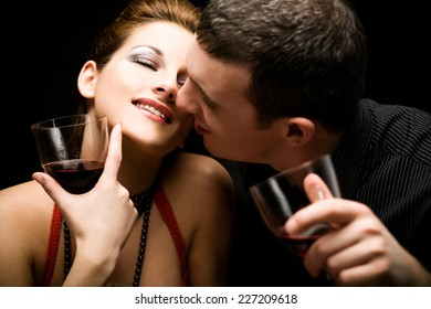 Close up of a happy couple holding wine glasses