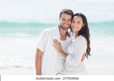 Close up of happy couple smiling at the beach